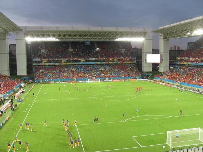 Watching a soccer match in a stadium is an essential Brazil activity