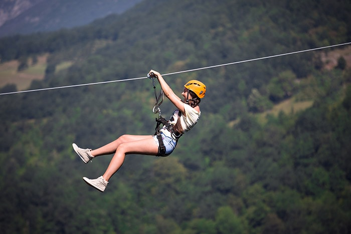 Woman gliding in zip line in Pedra Bela