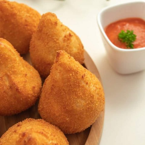 Coxinha de frango with chili sauce