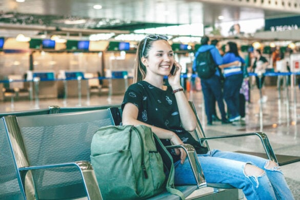 Girl talking on the phone at airport using a Brazil SIM card