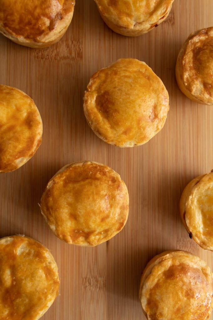 Chicken hand pies are called empadinhas de frango in Portuguese