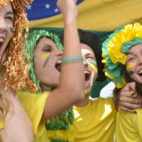 Group of happy Brazilian soccer fans