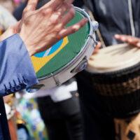 Playing samba on tambourine