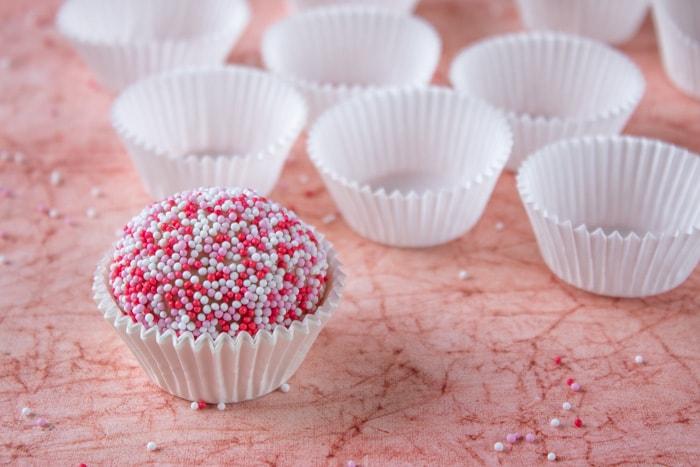 Strawberry brigadeiro near empty white cups