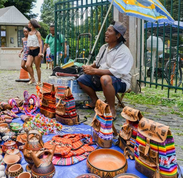 Indigenous Brazilian man selling arts and crafts at a street market in Belo Horizonte