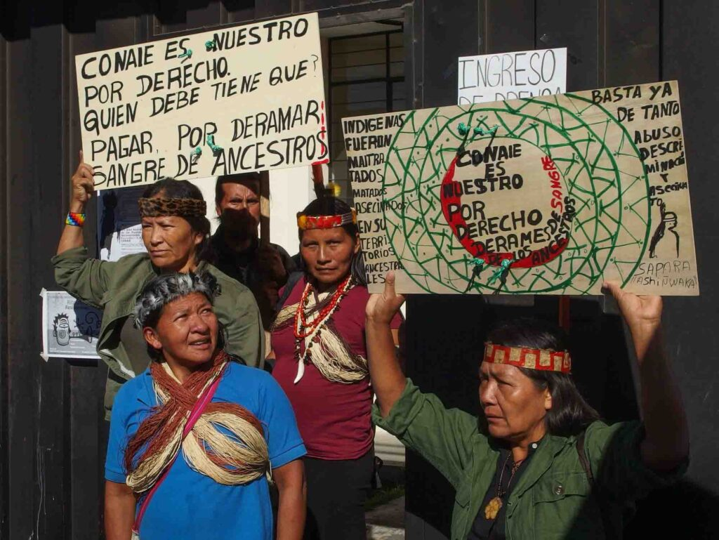 Amazonian Shuar women protesting against mining and oil drilling in the Amazon Rainforest