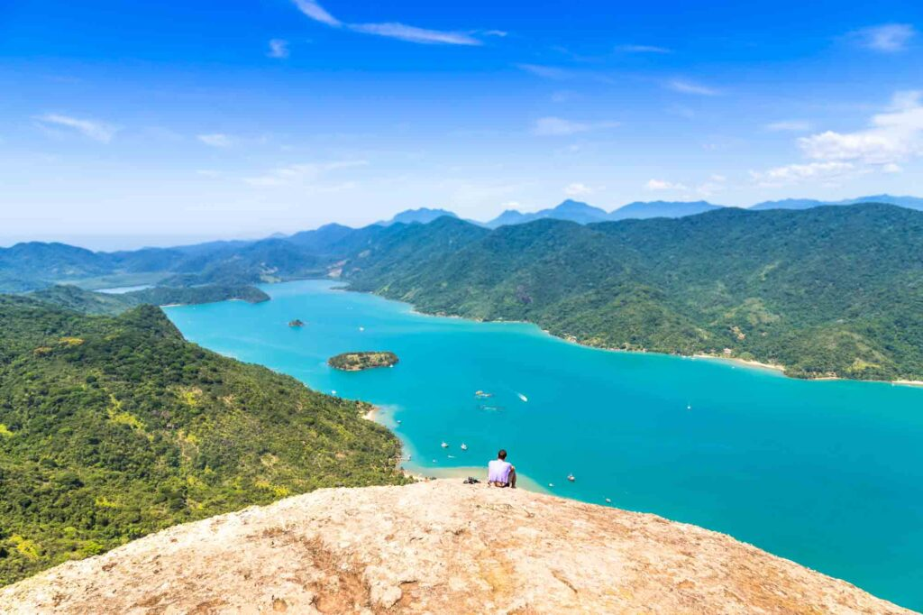Hiking to the world's only tropical Fjord is one of the cool things to do in Paraty, Brazil